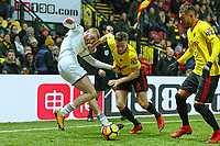 Oliver McBurnie of Swansea City challenged by Tom Cleverley and Roberto Pereyra of Watford during the Premier League match between Watford and Swansea City at the Vicarage Road, Watford, England, UK. Saturday 30 December 2017
