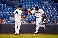 Lake County Captains Jhonkensy Noel (43) fist bumps manager Greg DiCenzo (23) as he rounds the bases after hitting a home run during a game against the Great Lakes Loons on August 28, 2021 at Classic Park in Eastlake, Ohio.  (Mike Janes/Four Seam Images)