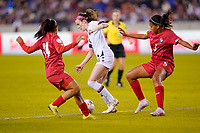 HOUSTON, TX - JANUARY 31: Rose Lavelle #16 of the United States moves past Maryorie Perez #14 and Yerenis  De Leon #5 of Panama with the ball during a game between Panama and USWNT at BBVA Stadium on January 31, 2020 in Houston, Texas.