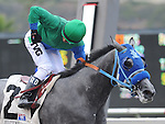 August 8, 2011. Rafael Bejarano riding Creative Cause gives a fist pump as he crosses the finish line and wins the Best Pal Stakes at the Del Mar Thoroughbred Club, Del Mar, CA