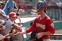 Harrisburg Senators outfielder Bryce Harper #34 signs autographs after a game against the Erie SeaWolves at Jerry Uht Park on August 7, 2011 in Erie, Pennsylvania.  Harrisburg defeated Erie 6-1.  (Mike Janes/Four Seam Images)