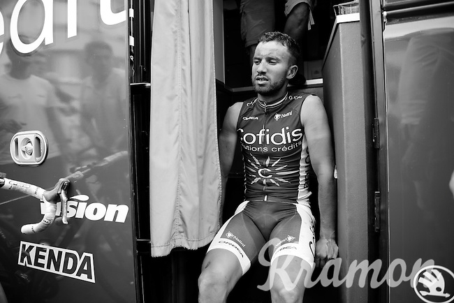 Nacer Bouhanni (FRA/Cofidis) resting on the teambus stairs after the race<br /> <br /> stage 4: Seraing (BEL) - Cambrai (FR) <br /> 2015 Tour de France