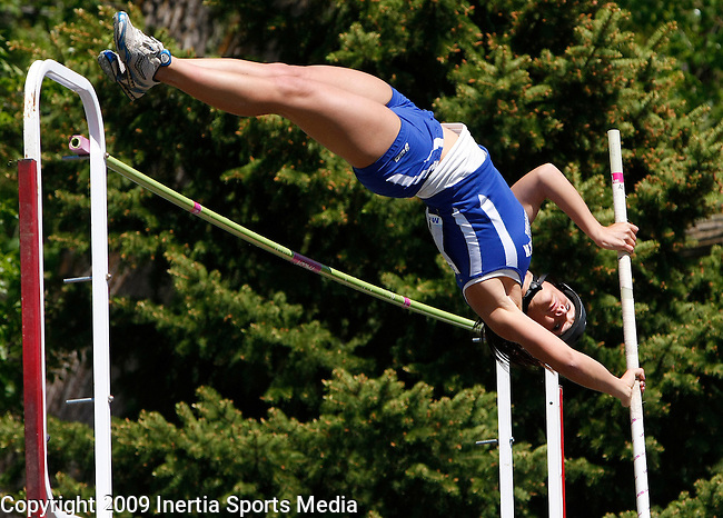 STURGIS, SD - MAY 29, 2009 :  Alli Arampatzis of Aberdeen Central lunges over the bar in the girls class AA pole vault event at the 2009 South Dakota State Track and Field meet in Sturgis Friday. (Photo by Dick Carlson/Inertia)