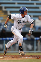 Asheville Tourists designated hitter Jordan Patterson #10 runs to first during game one of a double header against the West Virginia Power at McCormick Field on April 8, 2014 in Asheville, North Carolina. The Power defeated the Tourists 6-5. (Tony Farlow/Four Seam Images)