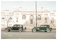 """Welcoming the new car models"" by Art Harman. The introduction of the latest models is always a time of excitement, and these new beauties gleamed in the sunshine. A shot of serendipity to capture these cars in a perdiod setting, and I processed the photo to emulate the look of 1930s photography."