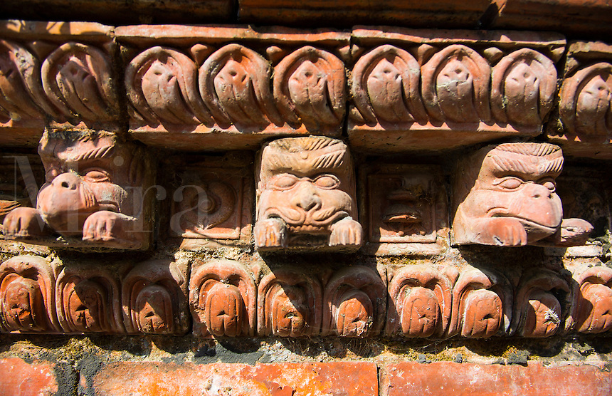 Kathmandu Nepal. Eastern Kathmandu Culture. A wall with multiple animal heads decorating its top in stone
