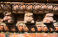 Kathmandu Nepal. Eastern Kathmandu Culture. A wall with multiple animal heads decorating its top in stone