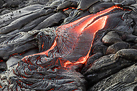 Pahoehoe (smooth, unbroken lava) flows over and through the coastal plains of Pulama Pali, Hawai'i Volcanoes National Park, Puna, Hawai'i Island, January 2018.