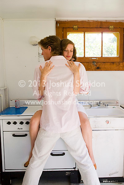 Young couple embracing on stove