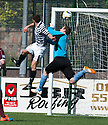 Queens Park's Shaun Frazer gets above Stenny goalkeeper Greg Fleming to score the equaliser.