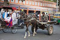 Jaipur, Rajasthan, India.  Street Traffic; Rickshaw with Passengers, Horse-drawn Cart.
