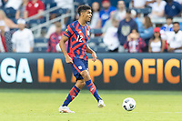 KANSAS CITY, KS - JULY 11: Miles Robinson #12 of the United States passes the ball during a game between Haiti and USMNT at Children's Mercy Park on July 11, 2021 in Kansas City, Kansas.