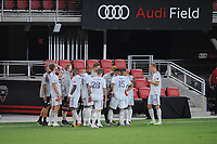 WASHINGTON, DC - AUGUST 25: New England Revolution taking a water break during a game between New England Revolution and D.C. United at Audi Field on August 25, 2020 in Washington, DC.