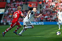 Sun 06 October 2013 Pictured:  ( L-R )  James Ward-Prowse of Southampton and Jonjo Shelvey of Swansea make a run for the ball Re: Barclays Premier League Southampton FC  v Swansea City FC  at St.Mary's Stadium, Southampton