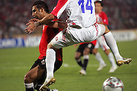 Egypt's Hosam Hassan (14) is leaped on by Costa Rica's Bryan Oviedo (14) after a failed goal attempt by Costa Rica during the FIFA Under 20 World Cup Round of 16 match between Egypt and Costa Rica at the Cairo International Stadium on October 06, 2009 in Cairo, Egypt.