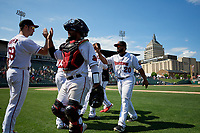 Rochester Red Wings Sean Poppen (59), Tomas Telis (18), and Wilin Rosario (20) celebrate after an International League game against the Scranton/Wilkes-Barre RailRiders on June 25, 2019 at Frontier Field in Rochester, New York.  Rochester defeated Scranton 10-9.  (Mike Janes/Four Seam Images)
