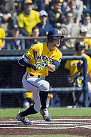 Michigan Wolverines first baseman Jake Bivens (18) follows through on his swing against the Illinois Fighting Illini during the NCAA baseball game on April 8, 2017 at Ray Fisher Stadium in Ann Arbor, Michigan. Michigan defeated Illinois 7-0. (Andrew Woolley/Four Seam Images)