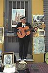 Carlos Gardel  look alike San Telmo Buenos Aires Street market scene <br />  man busking Argentina South America. 2000s 2002