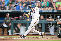 Michigan Wolverines catcher Joe Donovan (0) swings the bat against the Vanderbilt Commodores during Game 2 of the NCAA College World Series Finals on June 25, 2019 at TD Ameritrade Park in Omaha, Nebraska. Vanderbilt defeated Michigan 4-1. (Andrew Woolley/Four Seam Images)