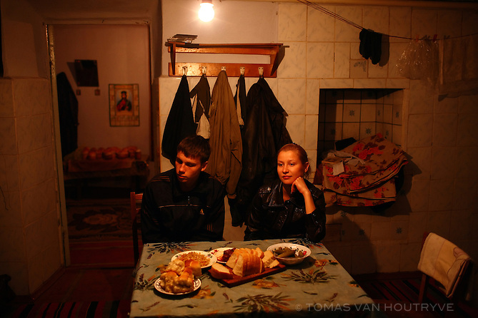The kitchen table in a farmhouse is set for dinner in the village of Chobruchi, Transnistria on 18 April 2009.