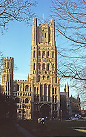 """Ely: Ely Cathedral--West elevation. Entrance--Galilee Porch. Early English, dating """"from about the time of Magna Carta"""". Photo '90."""