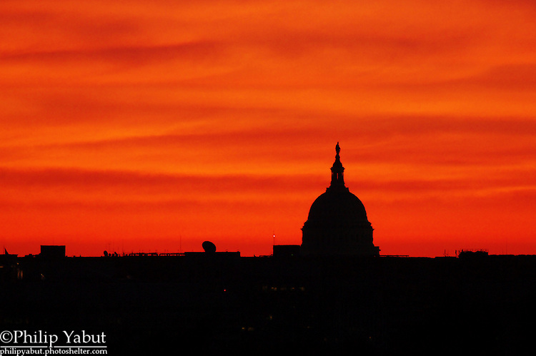 A red sky greets the U.S. Capitol just before sunrise.