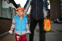 CHINA. Beijing. Li Rui'an (3) walking home from school with his father. Li Rui'an is the second child in the family. In wake of the approaching census, family's are having trouble registering their second child in the one-child state. 2010