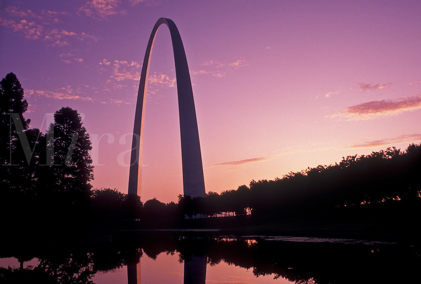 Gateway Arch, St. Louis, MO, Missouri, The Gateway Arch reflects in the pond at sunrise in Saint Louis. Jefferson National Expansion Memorial. Gateway to the West.