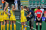The Hague, Netherlands, June 09: Players of Australia wave their hands after the team presentation and national anthem before the field hockey group match (Women - Group A) between England and Argentina on June 9, 2014 during the World Cup 2014 at Kyocera Stadium in The Hague, Netherlands. Final score 0-0 (0-0)  (Photo by Dirk Markgraf / www.265-images.com) *** Local caption *** Jodie Kenny #7 of Australia, Casey Eastham #4 of Australia, Madonna Blyth #12 of Australia