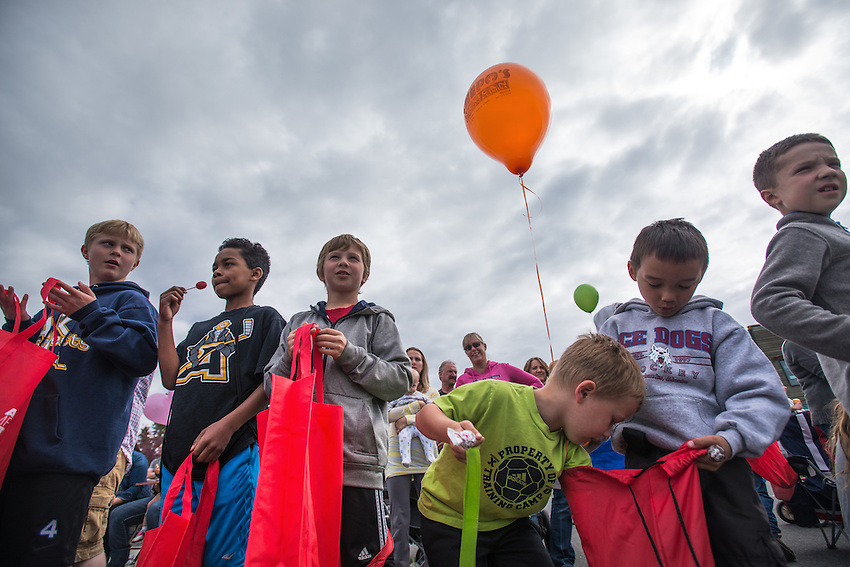 Kids wait for parade participants to throw candy during the Bear Paw Festival Grand Parade in downtown Eagle River.