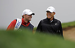 JEJU, SOUTH KOREA - APRIL 22:  Anthony Kim of USA and his caddie Brodie Flanders smiles on the 14th green during the Round One of the Ballantine's Championship at Pinx Golf Club on April 22, 2010 in Jeju island, South Korea. Photo by Victor Fraile / The Power of Sport Images