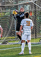 9 April 2021: University of Vermont Catamount Men's Soccer Goalkeeper Nate Silveira, a Senior from East Providence, RI, makes a second-half save against the University of New Hampshire Wildcats at Virtue Field in Burlington, Vermont. The Catamounts fell to the visiting Wildcats 2-1 for their first loss of the season in America East, Division 1 play. Mandatory Credit: Ed Wolfstein Photo *** RAW (NEF) Image File Available ***