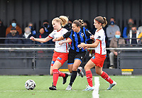 Essevee's Laura Vervacke pictured in a fight for the ball with Brugge's Jody Vangheluwe and Essevee's Amber De Priester during a female soccer game between Club Brugge Dames YLA and Zulte Waregem Ladies on the third matchday of the 2020 - 2021 season of Belgian Scooore Womens Super League , saturday 3 October 2020  in Brugge , Belgium . PHOTO SPORTPIX.BE | SPP | DAVID CATRY