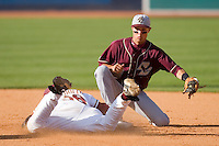 Second baseman Matt Hamlet #6 of the Boston College Eagles fields a throw as Stephen Cardullo #38 of the Florida State Seminoles slides safely into second base at Durham Bulls Athletic Park May 20, 2009 in Durham, North Carolina. (Photo by Brian Westerholt / Four Seam Images)