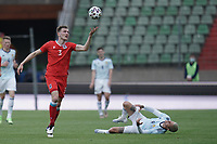 6th June 2021, Stade Josy Barthel, Luxemburg; International football friendly Luxemburg versus Scotland;  Enes Mahmutovic Luxembourg clashes with Lyndon Dykes Scotland