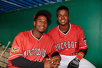 Batavia Muckdogs Samuel Castro and Dalvy Rosario in the dugout for a rain delay during a NY-Penn League game against the Auburn Doubledays on June 15, 2019 at Dwyer Stadium in Batavia, New York.  Batavia defeated Auburn 7-5.  (Mike Janes/Four Seam Images)