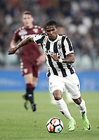 Calcio, Serie A: Torino, Allianz Stadium, 23 settembre 2017. <br /> Juventus' Douglas Costa in action during the Italian Serie A football match between Juventus and Tori0i at Torino's Allianz Stadium, September 23, 2017.<br /> UPDATE IMAGES PRESS/Isabella Bonotto