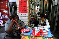 "Asien CHINA , Provinz Guangdong , Metropole Guangzhou (Kanton) , Viertel Xiaobei , hier leben viele tausende Haendler aus Afrika , kurz- oder langzeitig, legal oder illegal, die u.a.  in Grosshandels-/Exportmaerkten Textilien fuer Ihre Laeden in Afrika einkaufen  | .Asia CHINA Guangzhou , african trader buy and ship textiles to africa.  -   global trade trading economy .| [ copyright (c) Joerg Boethling / agenda , Veroeffentlichung nur gegen Honorar und Belegexemplar an / publication only with royalties and copy to:  agenda PG   Rothestr. 66   Germany D-22765 Hamburg   ph. ++49 40 391 907 14   e-mail: boethling@agenda-fototext.de   www.agenda-fototext.de   Bank: Hamburger Sparkasse  BLZ 200 505 50  Kto. 1281 120 178   IBAN: DE96 2005 0550 1281 1201 78   BIC: ""HASPDEHH"" ,  WEITERE MOTIVE ZU DIESEM THEMA SIND VORHANDEN!! MORE PICTURES ON THIS SUBJECT AVAILABLE!! ] [#0,26,121#]"
