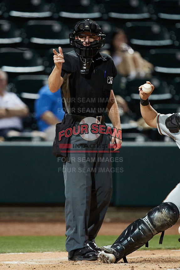 Home plate umpire Dylan Bradley makes a strike call during the game between the Greensboro Grasshoppers and the Winston-Salem Dash at Truist Stadium on June 15, 2021 in Winston-Salem, North Carolina. (Brian Westerholt/Four Seam Images)