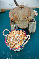 Hand mill and roasted Argan nuts. Cooperative Marjana, Ounara, Essouira, Morocco