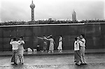 An early morning ballroom dance class on the Bund against the backdrop of the Oriental Pearl TV tower and the Jin Mao building. Ballroom dancing became popular during the 1980s as either a form of exercise or a competitive sport, not the social activity it was originally. Shanghai. The Peoples Republic of China. 2000.