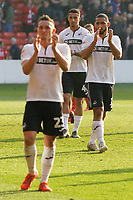 (L-R) Connor Roberts, Courtney Baker-Richardson and Cameron Carter-Vickers of Swansea City thank their away supporters during the Sky Bet Championship match between Nottingham Forest and Swansea City at City Ground, Nottingham, England, UK. Saturday 30 March 2019