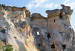 Homes carved from tufa formations or Peri Bacalari, Cappadocia, Turkey