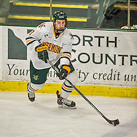 29 December 2014: University of Vermont Catamount Forward Kyle Reynolds, a Senior from Sylvan Lake, Alberta, in third period action against the Providence College Friars, during the deciding game of the annual TD Bank-Sheraton Catamount Cup Tournament at Gutterson Fieldhouse in Burlington, Vermont. The Friars shut out the Catamounts 3-0 to win the 2014 Cup. Mandatory Credit: Ed Wolfstein Photo *** RAW (NEF) Image File Available ***