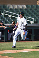 Salt River Rafters right fielder Sam Hilliard (14), of the Colorado Rockies organization, hustles towards home plate during an Arizona Fall League game against the Glendale Desert Dogs at Salt River Fields at Talking Stick on October 31, 2018 in Scottsdale, Arizona. Glendale defeated Salt River 12-6 in extra innings. (Zachary Lucy/Four Seam Images)