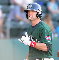 Outfielder Bryce Brentz (25) of the Greenville Drive signals to his parents sitting in the stands after extending his hitting streak to 26 games with two outs in the bottom of the ninth against the Charleston RiverDogs on May 15, 2011, at Fluor Field at the West End in Greenville, S.C. Photo by Tom Priddy / Four Seam Images