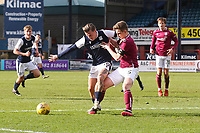 13th March 2021; Dens Park, Dundee, Scotland; Scottish Championship Football, Dundee FC versus Arbroath; Jason Cummings of Dundee challenges for the ball with Thomas O'Brien of Arbroath
