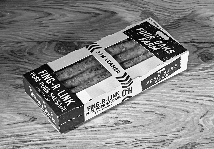 Client: A.W. Ripple Printing Company<br /> Ad Agency: None / A.W. Ripple<br /> Product: Four Oaks Farm Sausage<br /> Location: Brady Stewart Studio, 812 Market Street, Pittsburgh.<br /> <br /> Studio photography of a Four Oaks Farm box of Fing-R-Link pure pork sausage.  The assignment was for A.W. Ripple Printing company.  Four Oaks Farm is a fourth-generation company located in Lexington South Carolina.