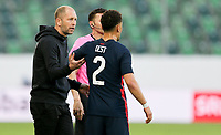 ST. GALLEN, SWITZERLAND - MAY 30: Gregg Berhalter  head coach of the United States has a few words with his defender Sergino Dest #2 during a game between Switzerland and USMNT at Kybunpark on May 30, 2021 in St. Gallen, Switzerland.