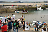 Tourists at the harbour in Padstow, North Cornwall.